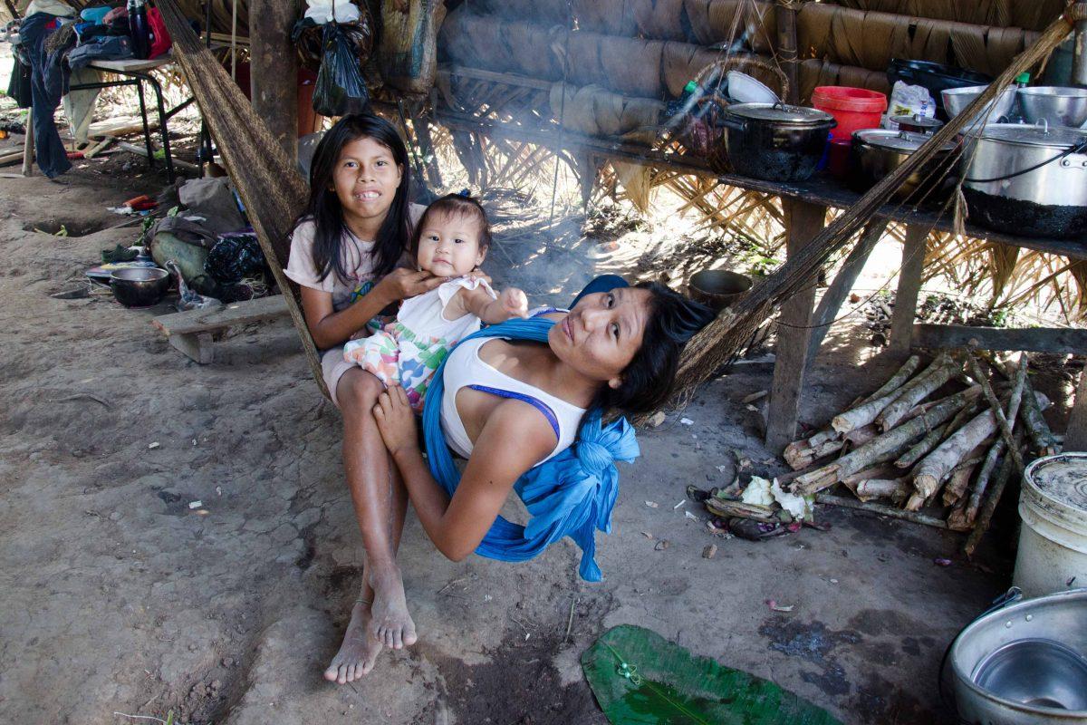 A Huaorani family asked to have their picture taken, Pastaza, Ecuador   ©Angela Drake
