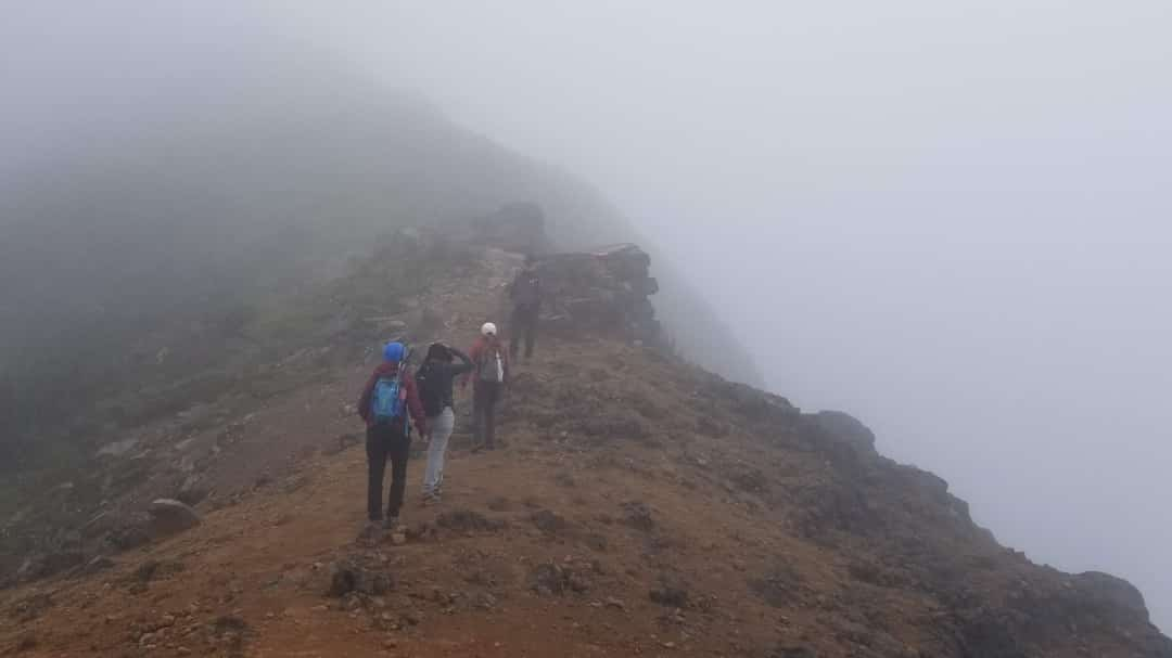 One hiker arriving at the summit of Pichincha